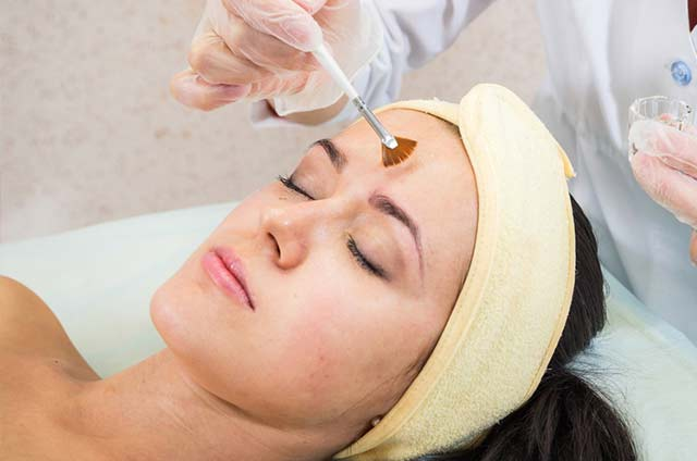 AHA chemical peel performed on attendee during hands-on training
