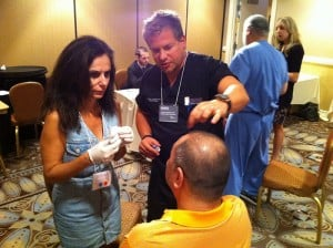 Stephen Cosentino, DO reviewing injection procedure