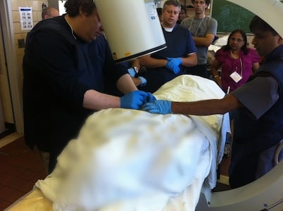 Student performing Lumbar Injection during Supervised Hands-On Cadaver Training
